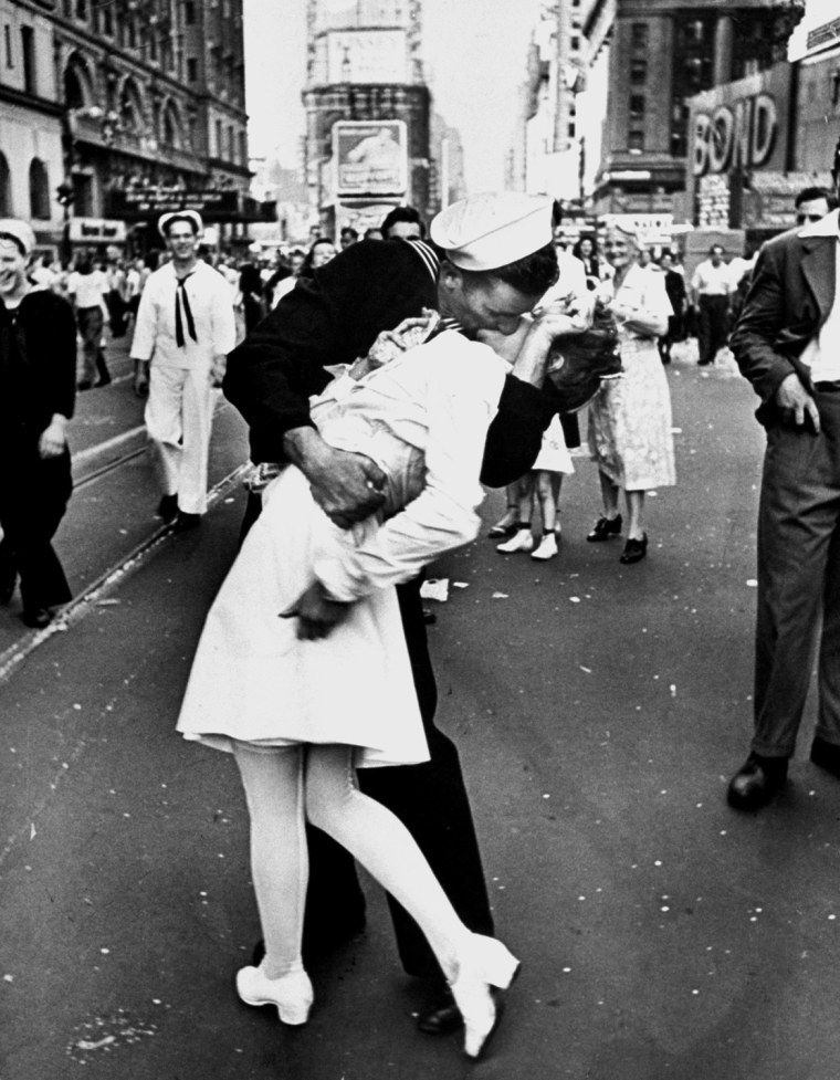 Image: A jubilant American sailor clutching a w