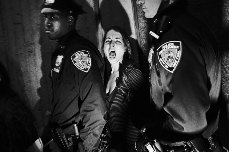 Image: Tomasz Lazar of Poland has won the second prize People in the News Singles with this picture of an arrest of protesters in Harlem, New York City