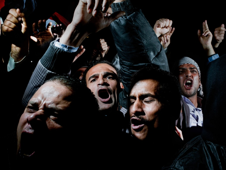 Image: Alex Majoli of Italy has won the first prize General News Singles with this picture of protesters crying, chanting and screaming in Cairo's Tahrir Square