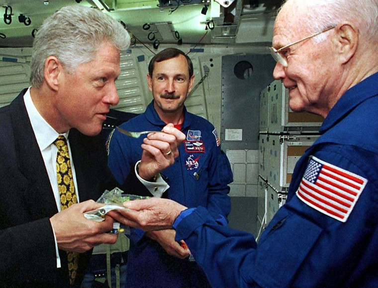 Image: President Clinton gets a helping of a space shuttl
