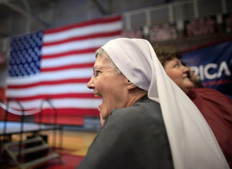 "Image: Sister Grace Anne Wills cheers as Republican U.S. presidential candidate and former U.S. Senator Rick Santorum is named the winner in the Tennessee primary at Santorum's ""Super Tuesday"" primary election night rally in Steubenville"