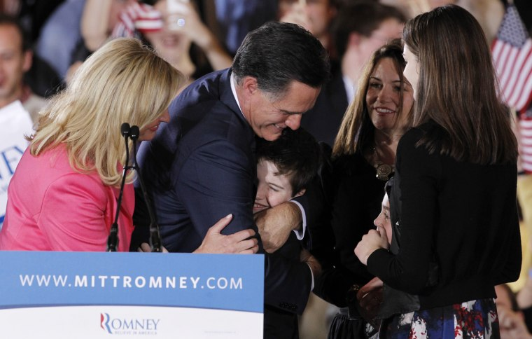 "Image: Republican U.S. presidential candidate Mitt Romney hugs family members with his wife Ann at his side after speaking at his ""Super Tuesday"" primary election night rally in Boston"