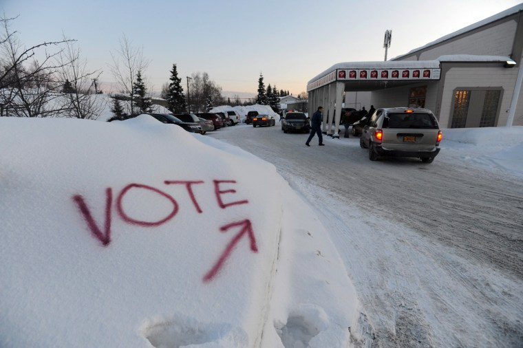 Image: Voters cast ballots in Alaska