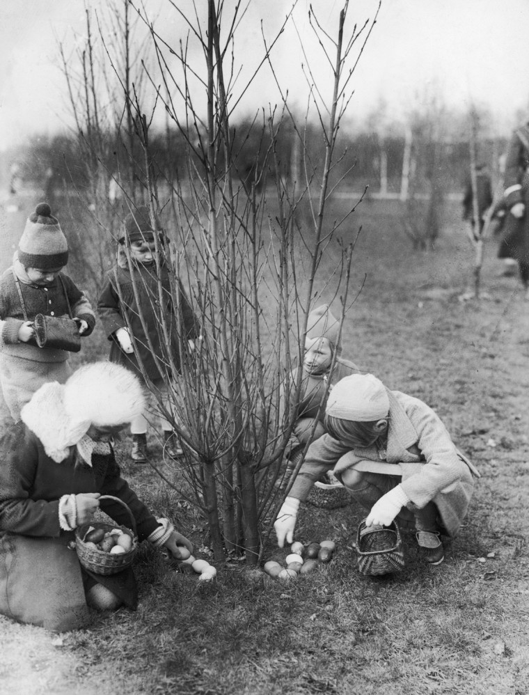 Subject: Children collecting easter eggs into their baskets. Date: 1930s TIme Life Mansell Merlin- 1139022