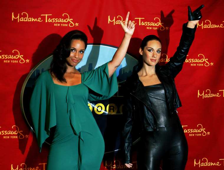 Image: Singer Alicia Keys poses with her new wax figure at Madame Tussauds in New York
