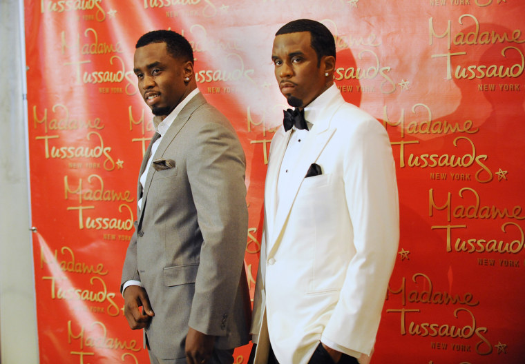 "Musician Sean ""Diddy"" Combs (L) poses wi"