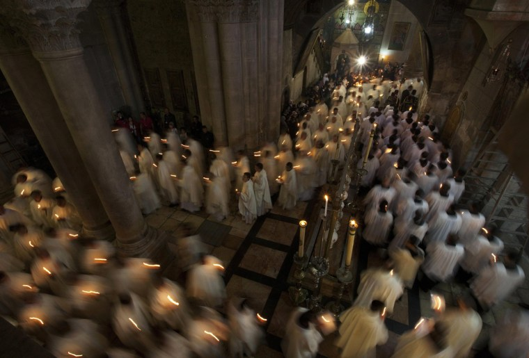Image: Members of the Catholic clergy hold candles during Washing of the Feet ceremony ahead of Easter in Jerusalem