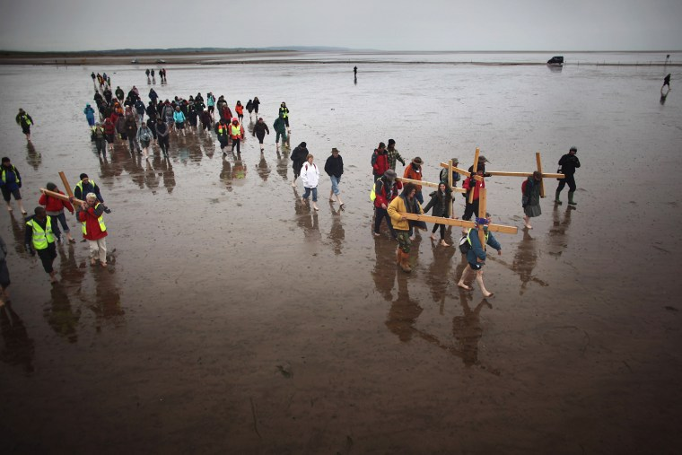 Image: Pilgrims From Across The UK Carry Crosses To Holy Island