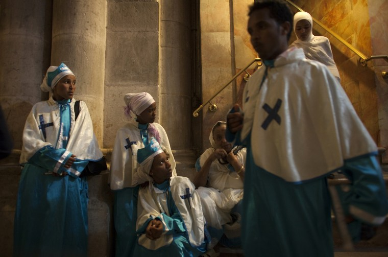 Image: Christian worshippers visit the Church of Holy Sepulchre during Easter celebrations in Jerusalem's Old City