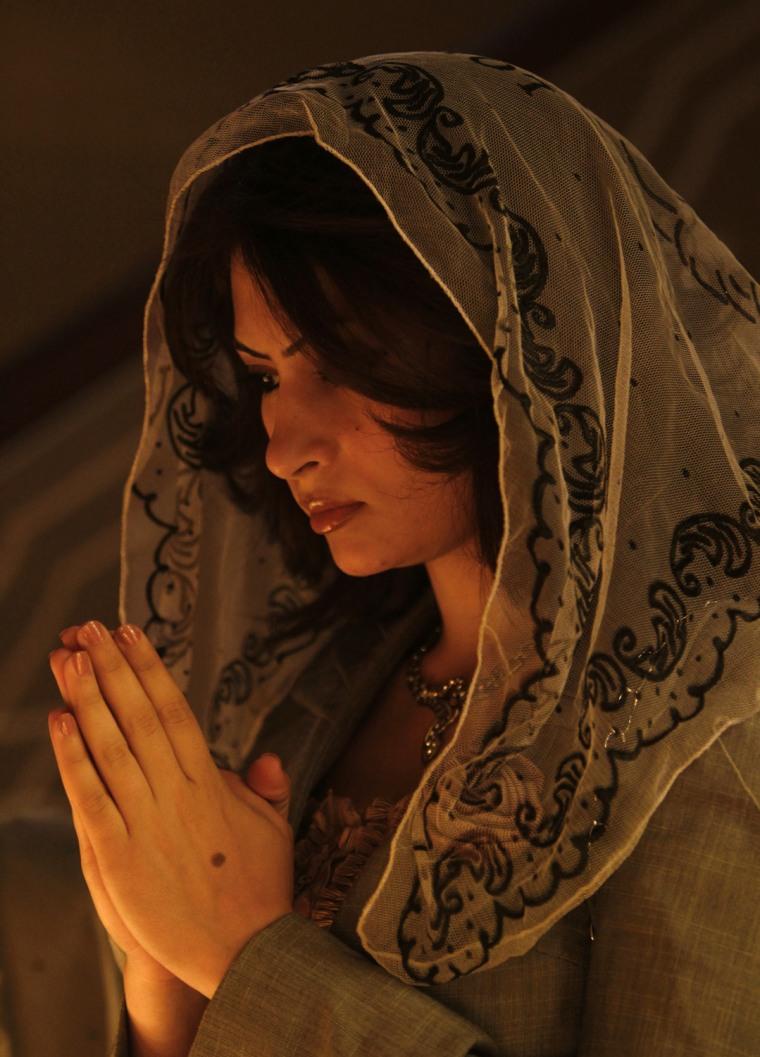 Image: An Iraqi Christian prays during an Easter mass at Armenian Church in Baghdad