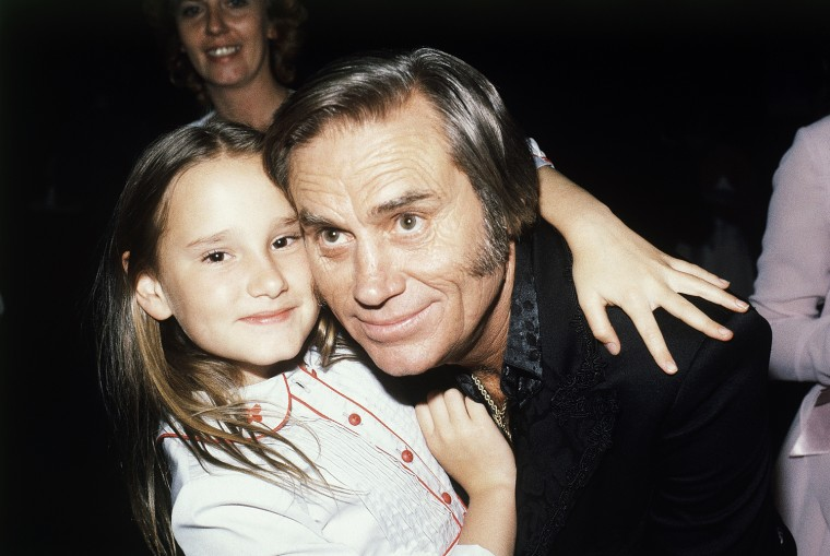 Singer George Jones, winner of top male vocalist award at the Academy of Country Music Awards, poses with his daughter Georgette, April 30, 1981, Calif. (AP Photo)