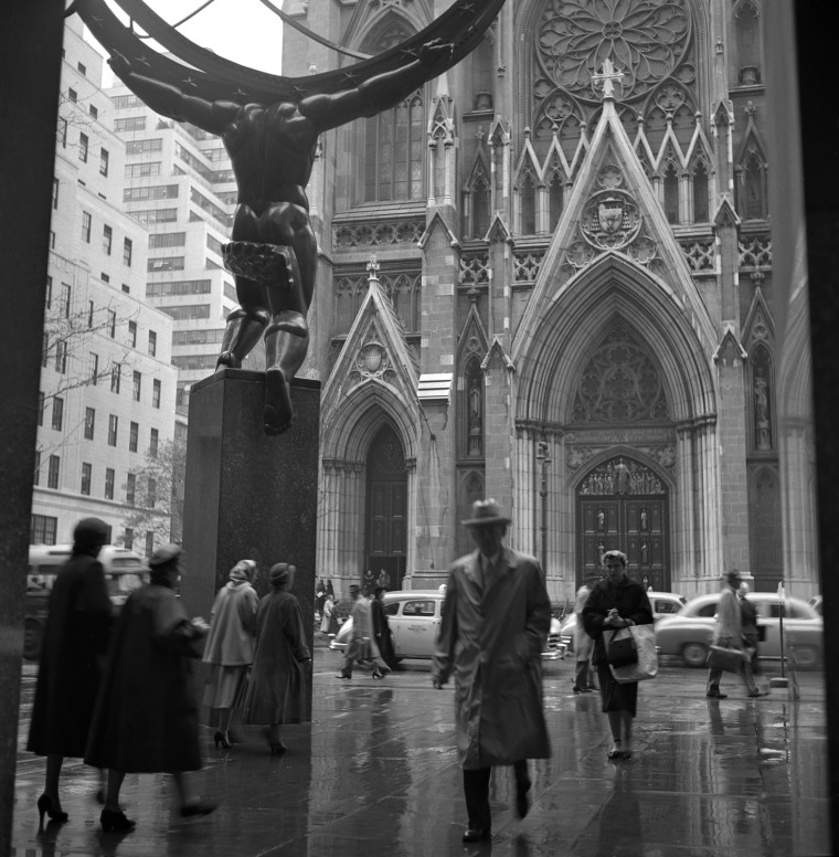 This shot, taken on a rainy day across from St. Patrick's Cathedral, is one of thousands of snaps found in an attic in 2009. After his two sons left home, Frank Larson found more time to fulfill his passion for picture-taking.  <br><br> The thousands of negatives discovered, according to the Queens Museum of Art, were organized into more than 100 envelopes onto which Larson had carefully noted the locations, dates and times they were taken.