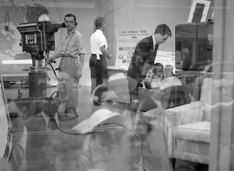 "The set of NBC's ""Today Show"" is seen though a reflection of people outside peering into the window in April of 1954."