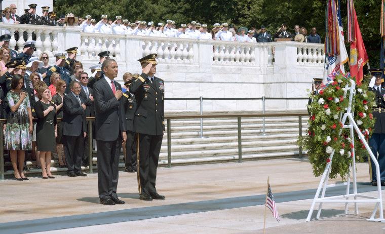 Image: US President Barack Obama escorted by Mi