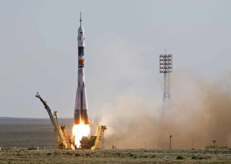 Image: The Soyuz TMA-04M spacecraft carrying an International Space Station (ISS) crew blasts off from its launch pad at Baikonur cosmodrome