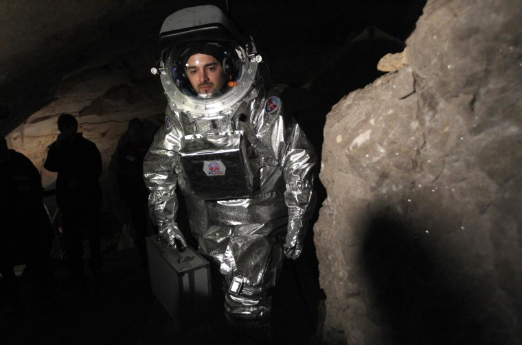 Image: Physicist Schildhammer wears Aouda.X spacesuit simulator during field test inside giant ice cave at Dachstein mountain