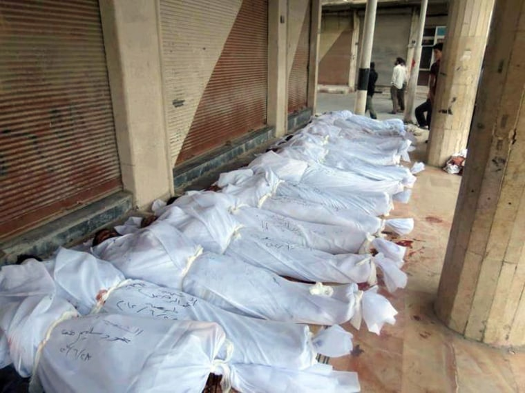 Image: Bbodies of people allegedly killed by government forces in Douma on June 28.