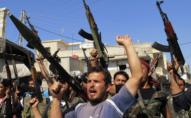 Image: Members of the Free Syrian Army chant slogans against Syrian President Bashar al-Assad in Azzaz