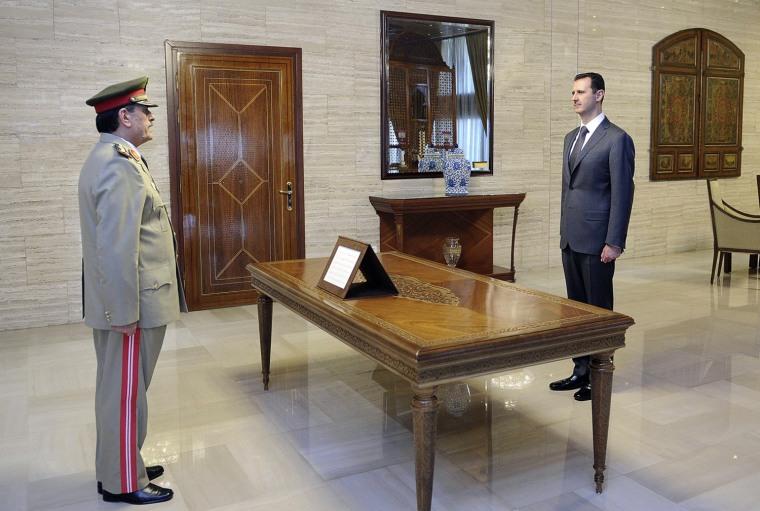 Image: General Fahad Jassim al-Freij is sworn in as Defence Minister by Syrian President Bashar al-Assad in Damascus