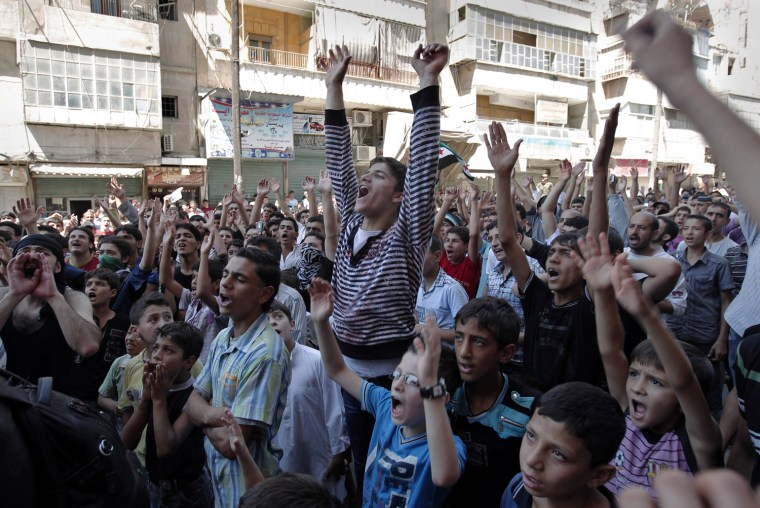 Image: Syrian anti-regime protesters shout slog