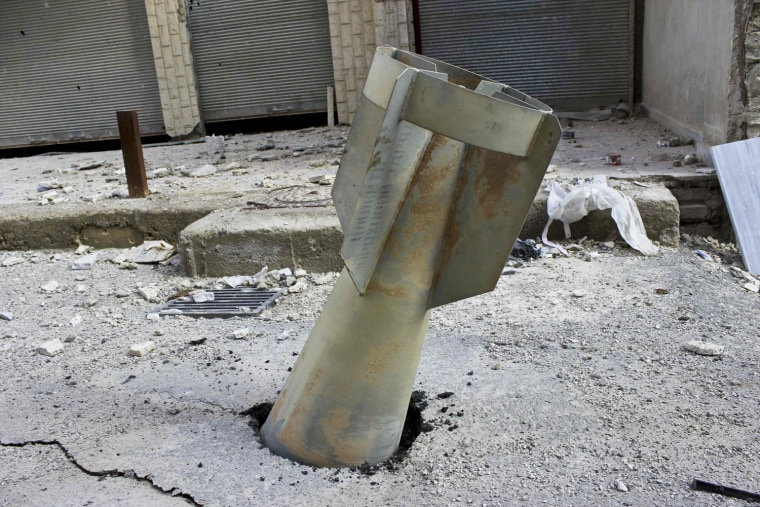Image: An unexploded ordnance is seen in the Ain Terma area in Ghouta, east of Damascus