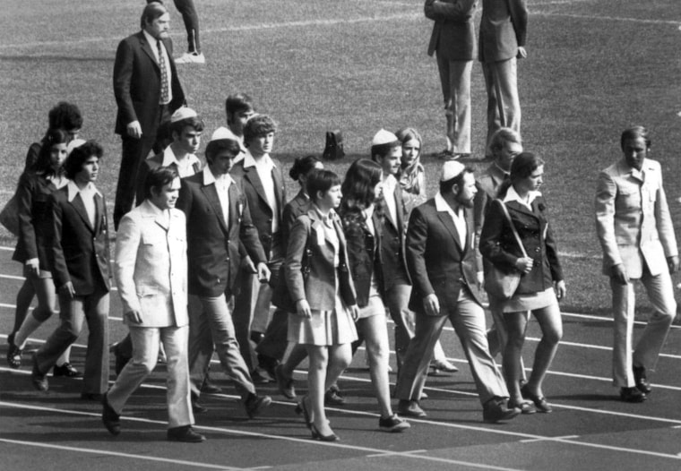 Members of the Israeli team march on the field of