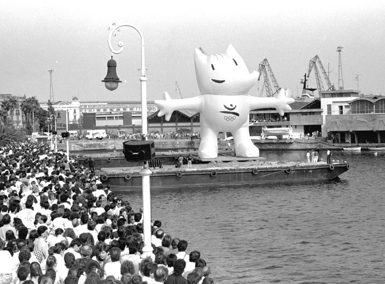 Cobi, official mascot of the 1992 Summer Olympic Games in Barcelona, comes up to the surface in Barcelona's Port Sunday October 9, 1992 during the celebration of the arrival of the Olympic Flag, .  (AP Photo/Amicar de Leon)