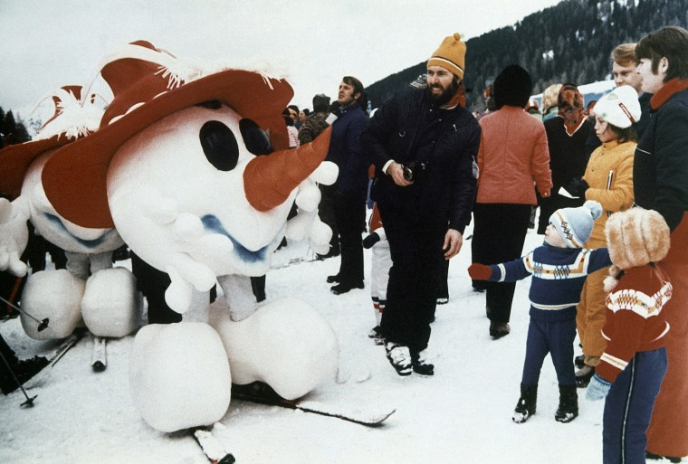 These Disney-style Tyrolean characters appeared for the first time at Kitzbuhel, Austria during the world downhill ski events, January 1975. They represent the official Mascot for the Winter Olympic Games, to be held around Innsbruck, Austria, 1976.