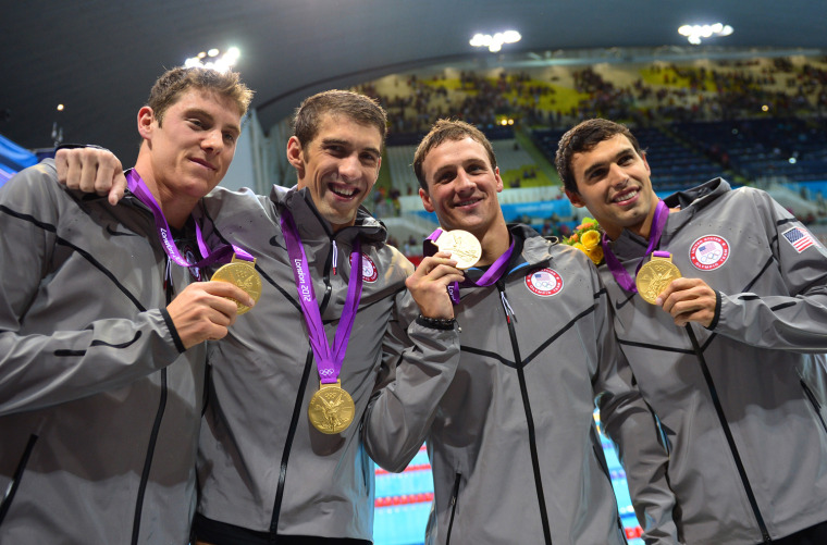 Image: (L-R) US swimmers Conor Dwyer, Michael P