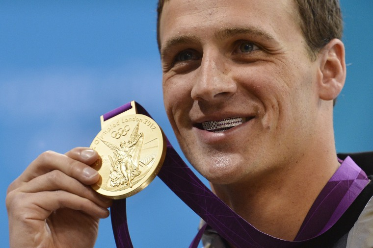Image: US swimmer Ryan Lochte poses on the podi
