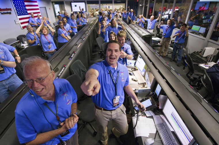 Image: The Mars Science Laboratory (MSL) team in the MSL Mission Support Area reacts after learning the Curiosity rover has landed safely on Mars, at the Jet Propulsion Laboratory in Pasadena