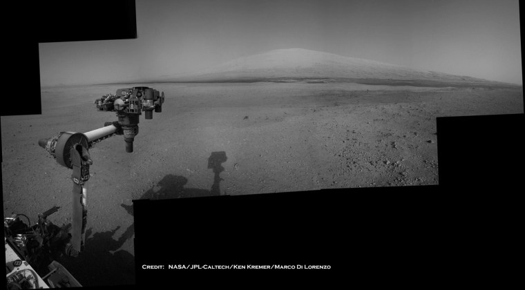 Image: Image: The Mars Curiosity rover's robotic arm takes aim at Mount Sharp in a mosaic that combines navigation-camera imagery from Sols 2, 12 and 14 (Aug. 8, 18 and 20).