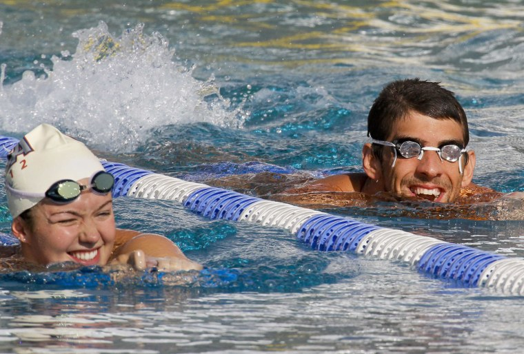 Image: Members of U.S. national Olympic swimming team Franklin and Phelps smile during a training session for the London 2012 Olympics in Bellerive