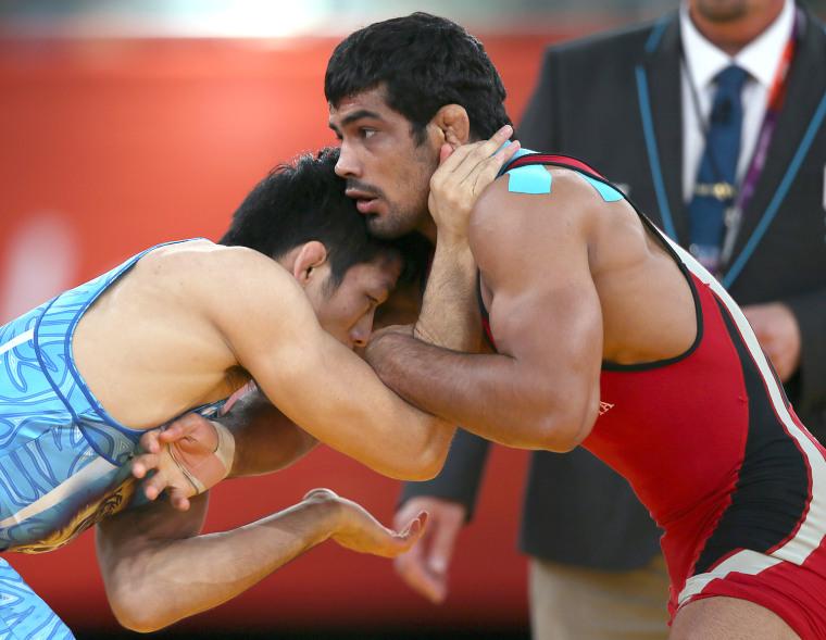 Image: India's  Sushil Kumar (R) wrestles Japan