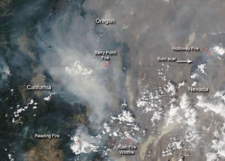 Image: NASA handout photo of wildfires burning in California, Nevada and Oregon