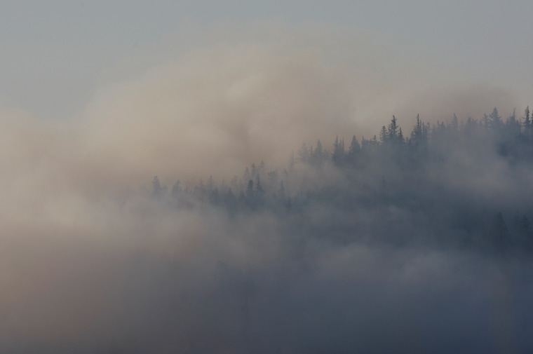 Image: Smoke can be seen as crews continue to battle the Taylor Bridge Fire near Cle Elum