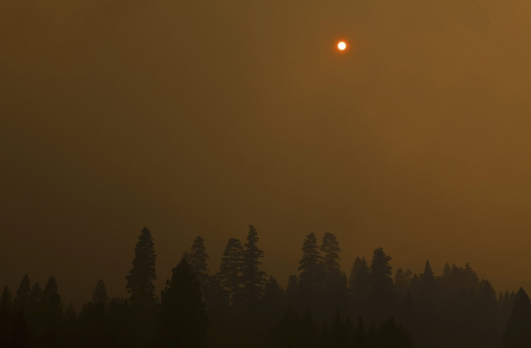 Image: The sun is obscured over the Chips fire near Greenville, California