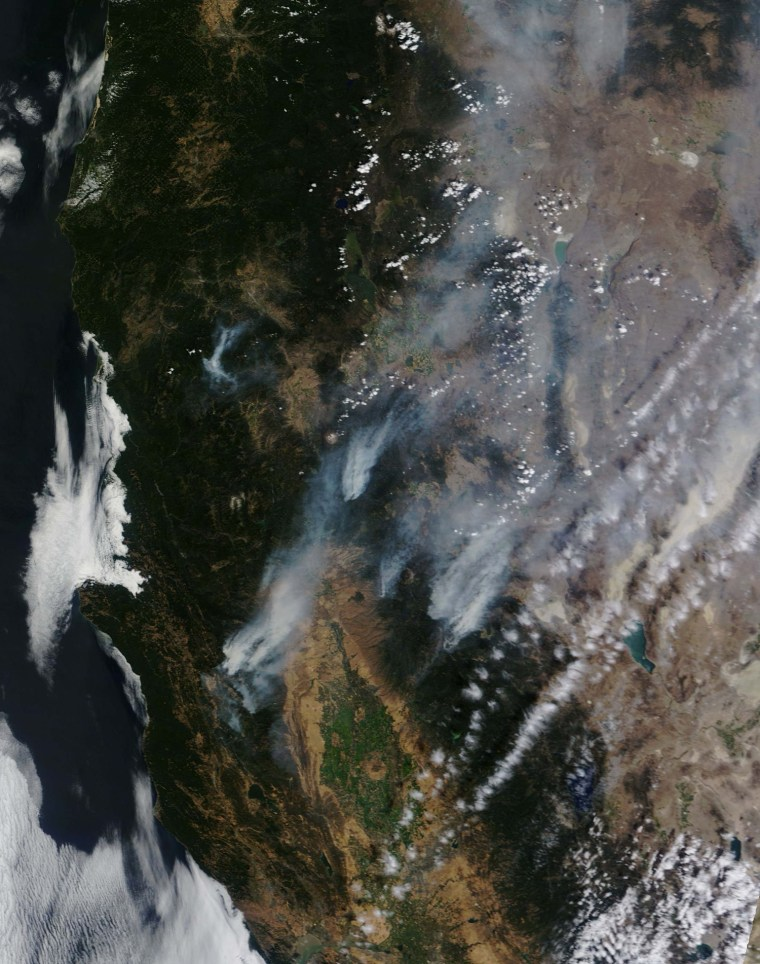Image: NASA handout satellite image shows forest fires in Northern California