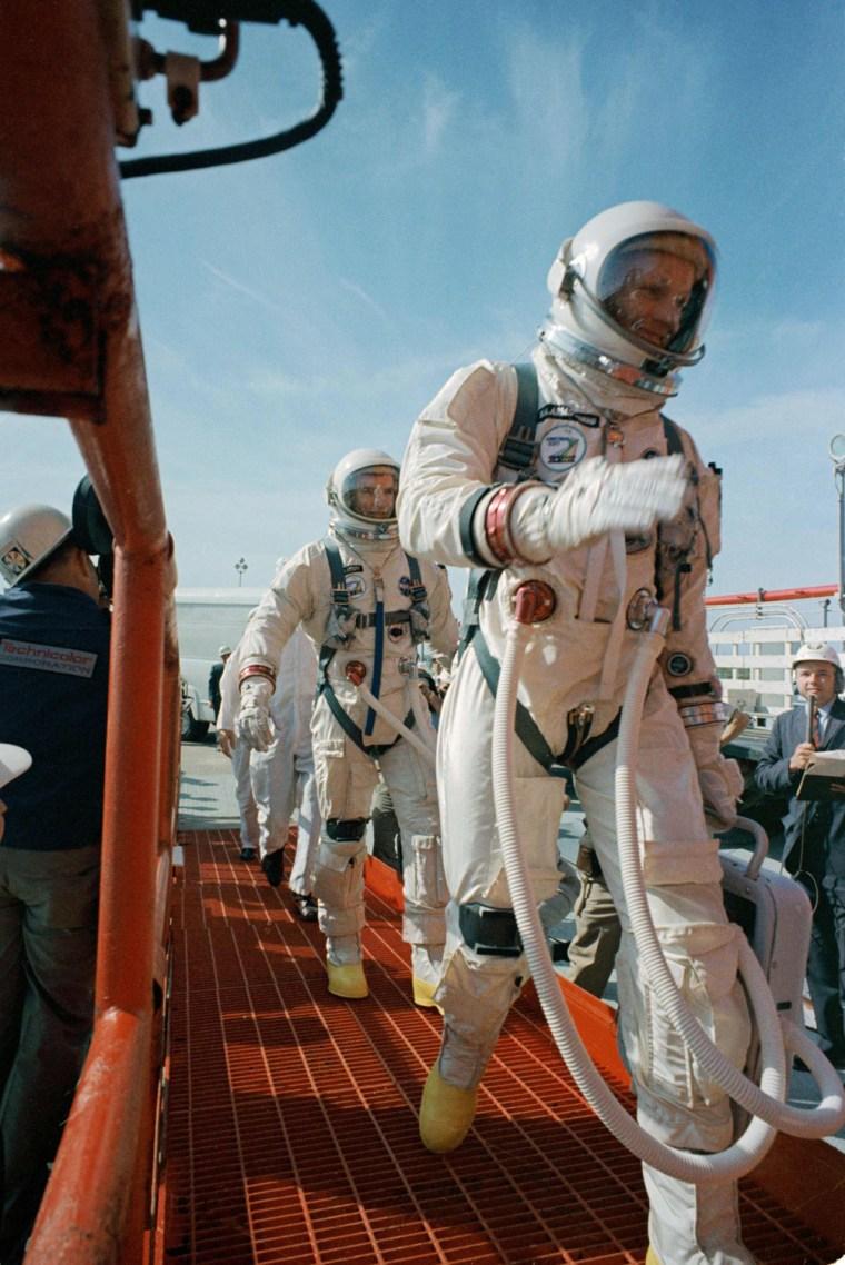 Image: NASA file image of Commander Neil Armstrong and pilot David R. Scott prepare to board the Gemini-Titan VIII
