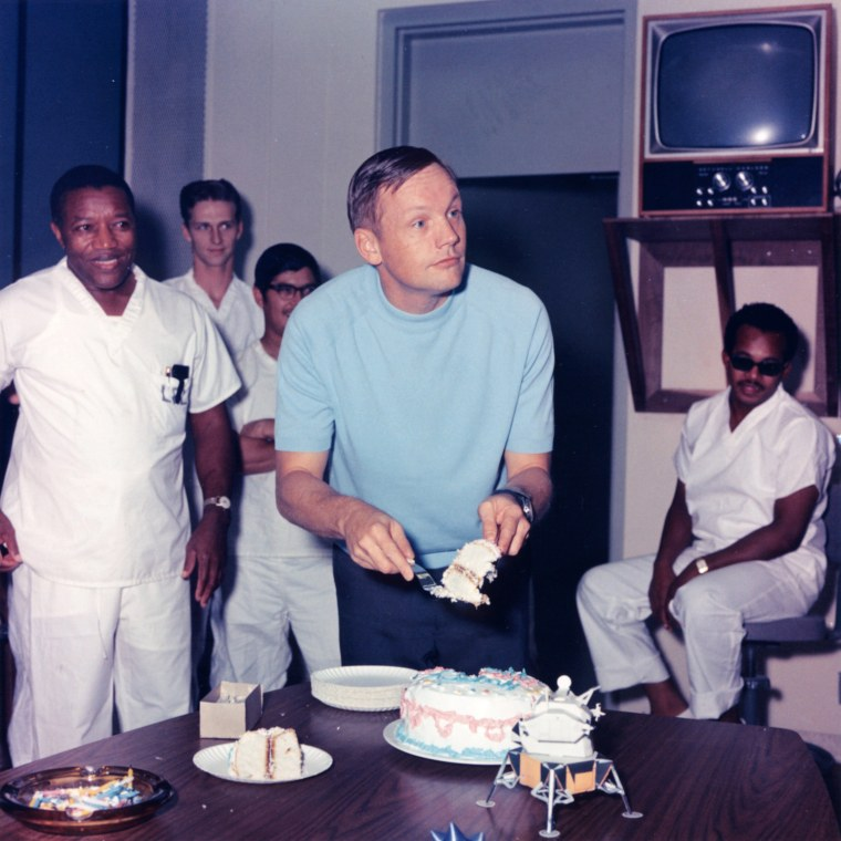 Image: Handout photo of Armstrong cutting a cake