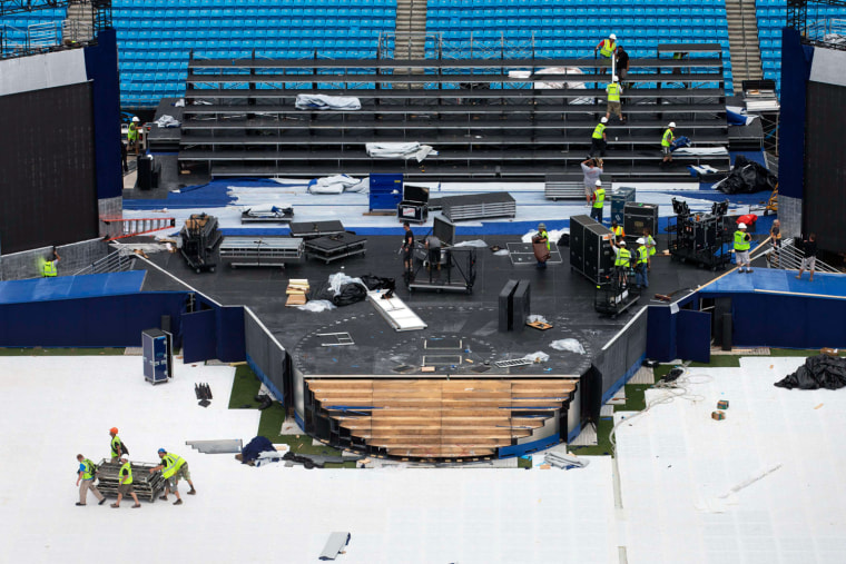 Image: Workers dismantle the stage set for President Obama at the Bank of America stadium in Charlotte