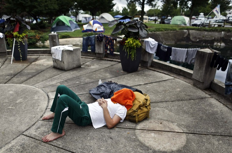 Image: A protester sleeps at Marshall Park during the second day of the Democratic National Convention in Charlotte