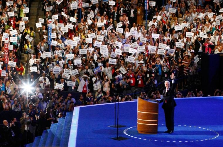 Image: Former President Bill Clinton waves as he begins to address delegates during the second session of the Democratic National Convention in Charlotte
