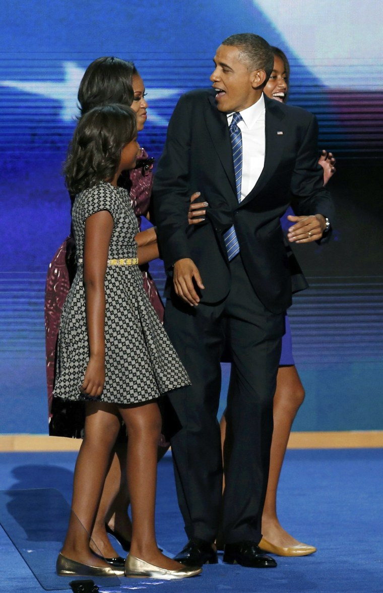 Image: U.S. President Barack Obama is joined onstage by his family after he accepted the U.S Democratic presidential nomination during the final session of the Democratic National Convention in Charlotte