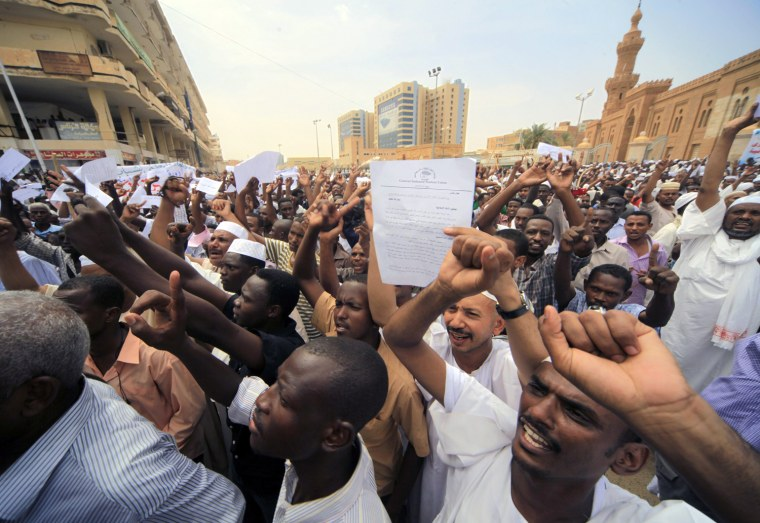 Image: Sudanese demonstrators walk out after Friday prayers to the German and U.S. embassies in Khartoum