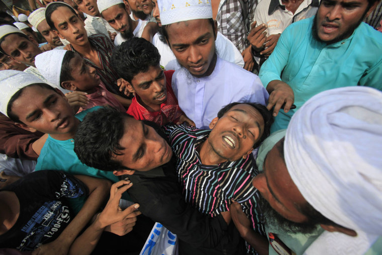 Image: Man faints during a protest rally after Friday prayers near the U.S embassy in Dhaka