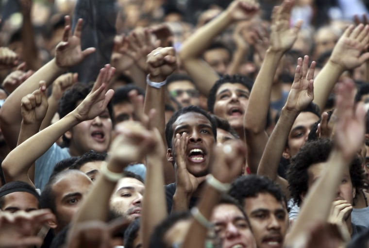 Image: People shout slogans in front of the U.S. embassy during a protest in Cairo