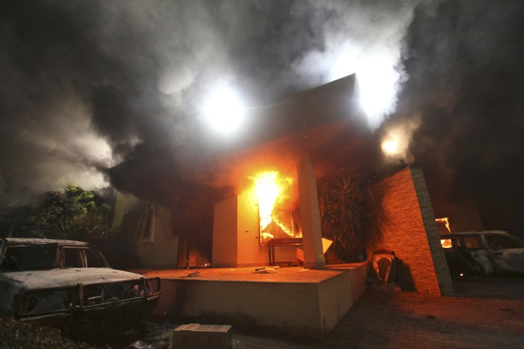 Image: The U.S. Consulate in Benghazi is seen in flames during a protest by an armed group said to have been protesting a film.