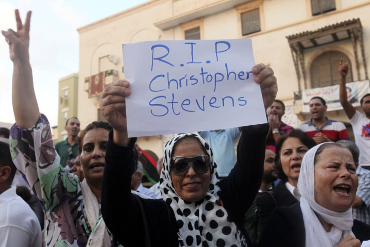 Image: A demonstrator holds placard during a rally to condemn the killers of the U.S. Ambassador to Libya in Benghazi