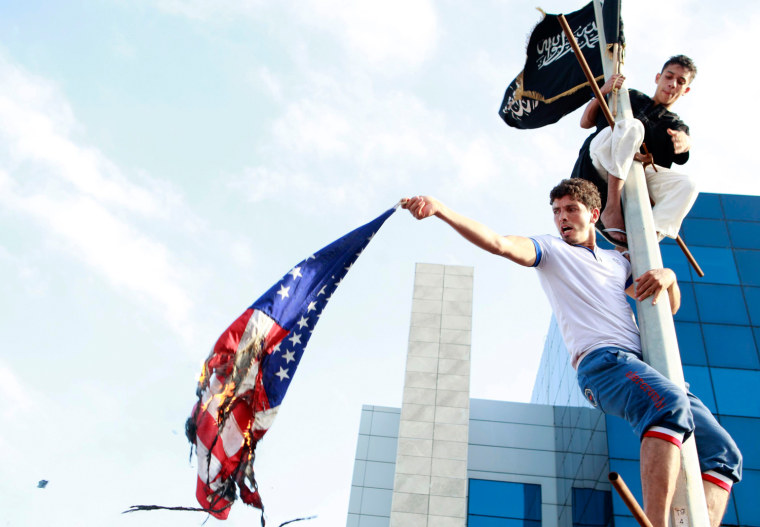 Image: Tunisian protesters burn the U.S. flag during a demonstration outside the U.S. embassy in Tunis